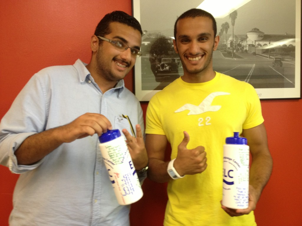 Al Saqer brothers with their water bottles