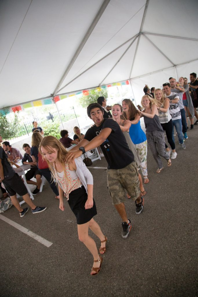Students dancing in conga line