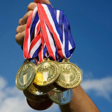ELC Blog: English Grammar Lesson – Going for Gold with -ing Verbs!